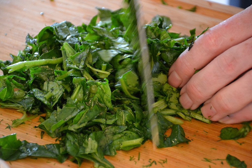 Cut-the-spinach-for-the-Koulourakia- Spinach- Cookies