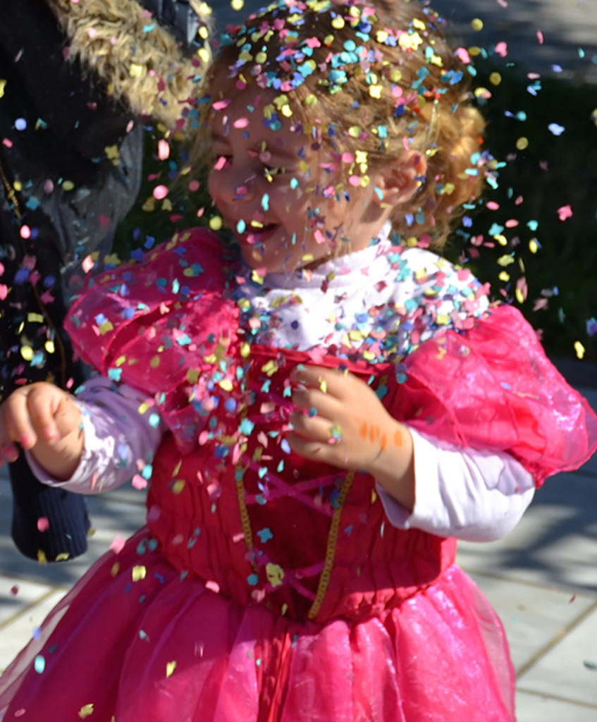 Girl-covered-in-confetti-Greek-Carnival-Poros
