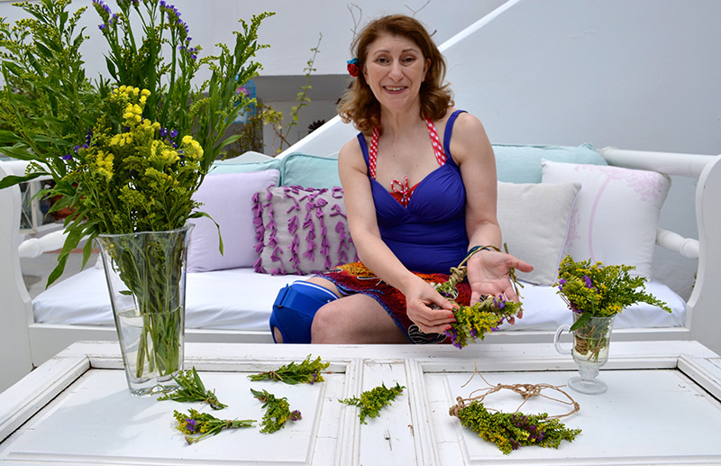 Roz-making-garlands-with-flowers-at-Odyssey