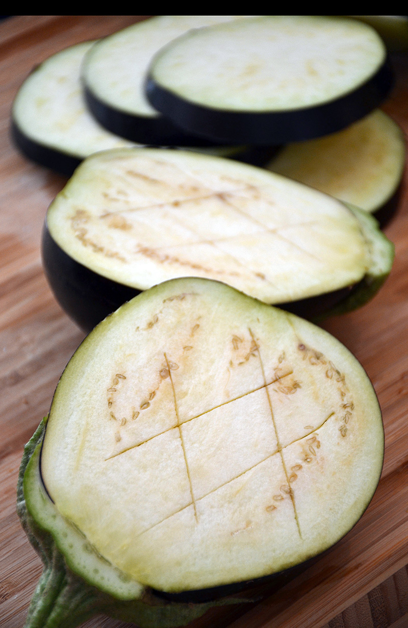 Cut the eggplants before they go into the oven