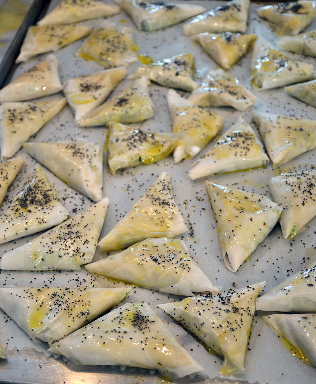 Spanakopitakia Spinach Triangles ready for the oven.