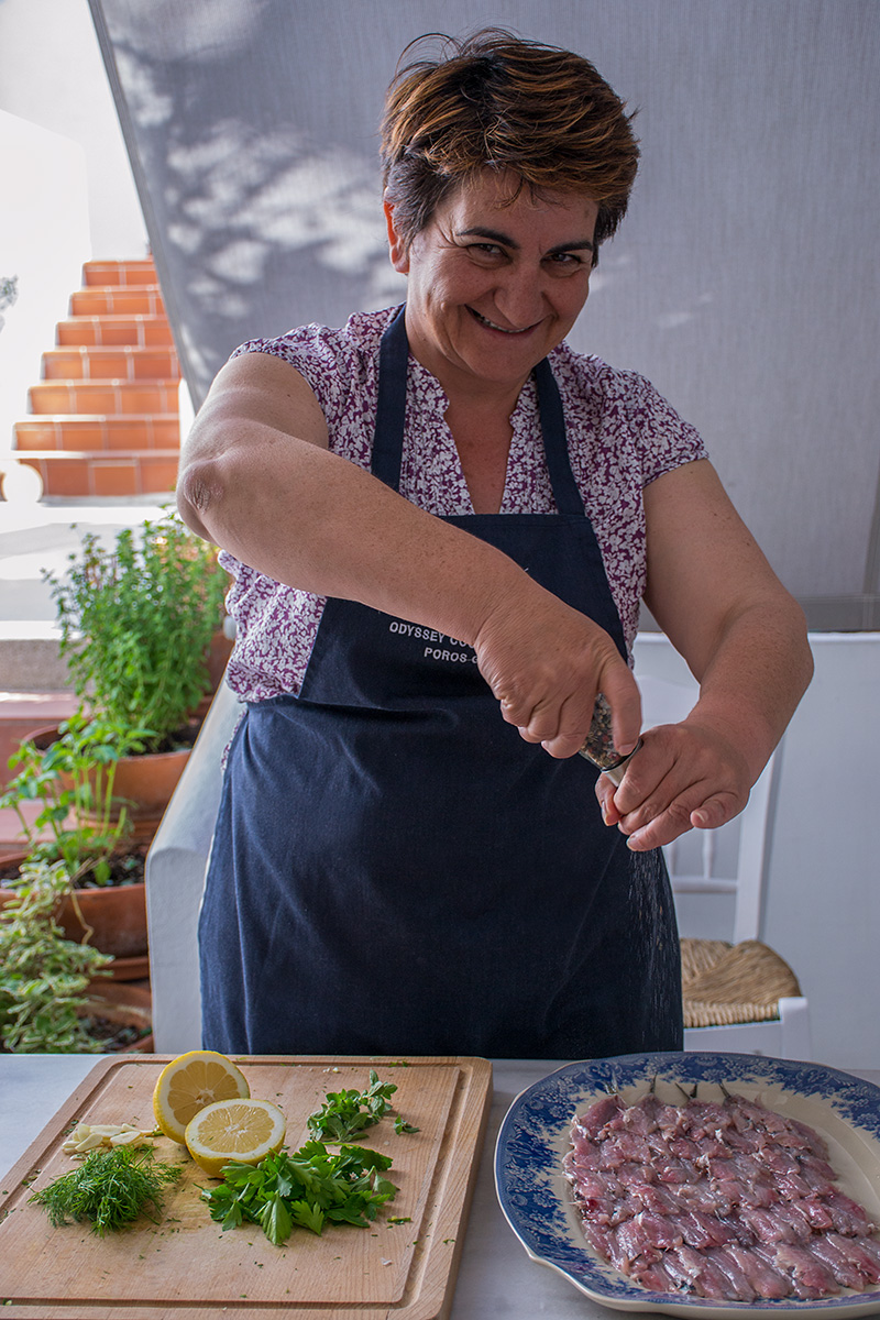 Katerina marinating the raw anchovies Odyssey Poros Greece