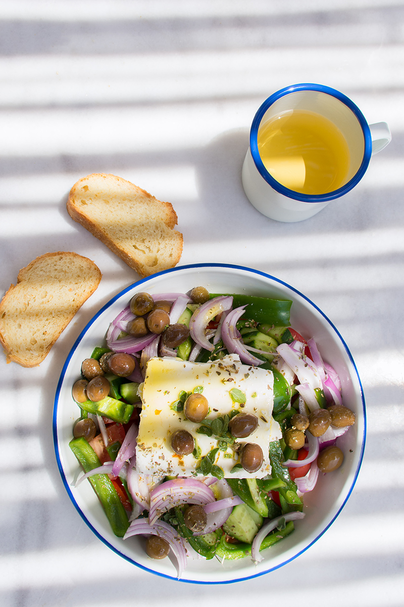 Greek Salad on the summer table Odyssey Poros Greece