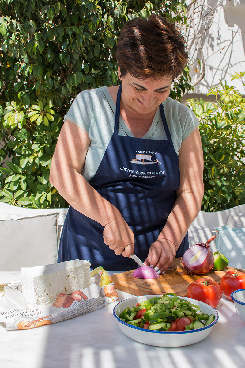 Katerina preparing a Greek Salad Odyssey Poros Greece