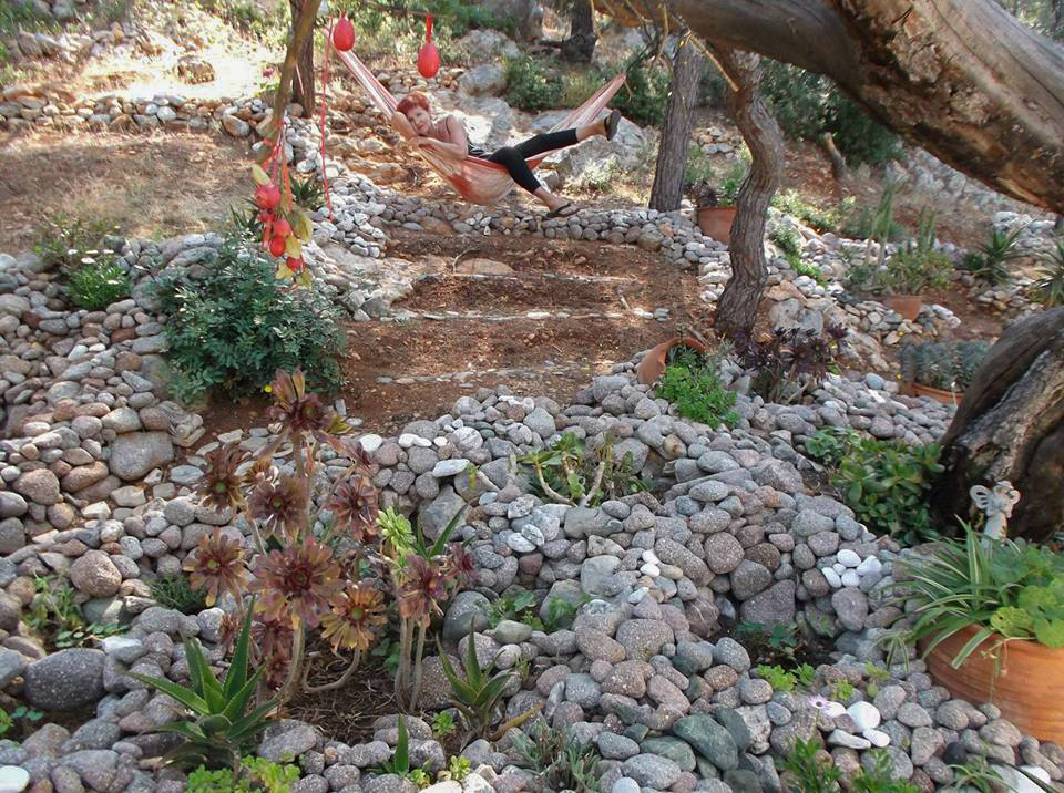 Mari in her beloved rock-garden on Poros Greece