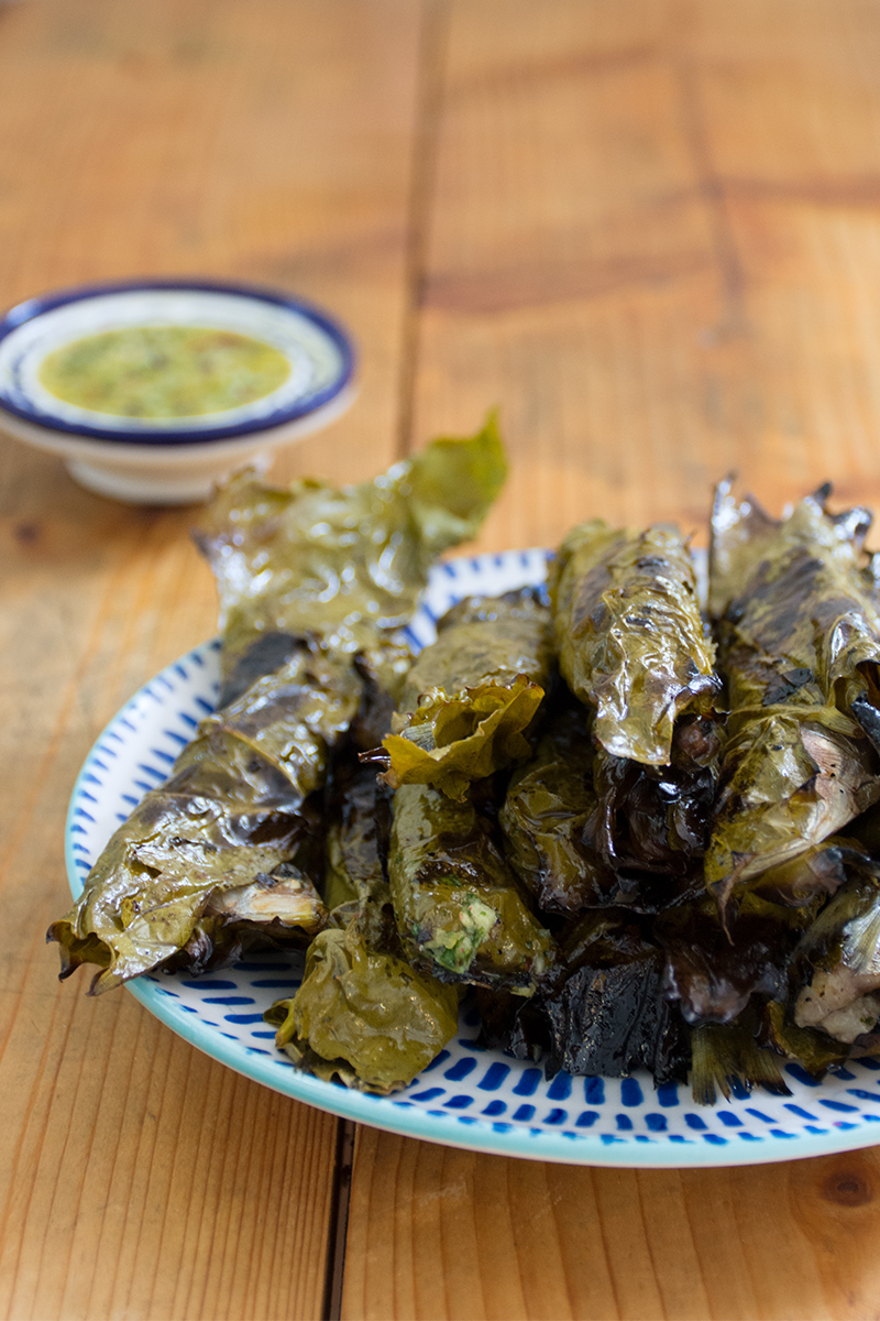 Grilled sardines in grape leaves with lemon-sauce Greece Poros fish recipe