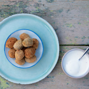 Deep-fried stuffed olives with ouzo dip