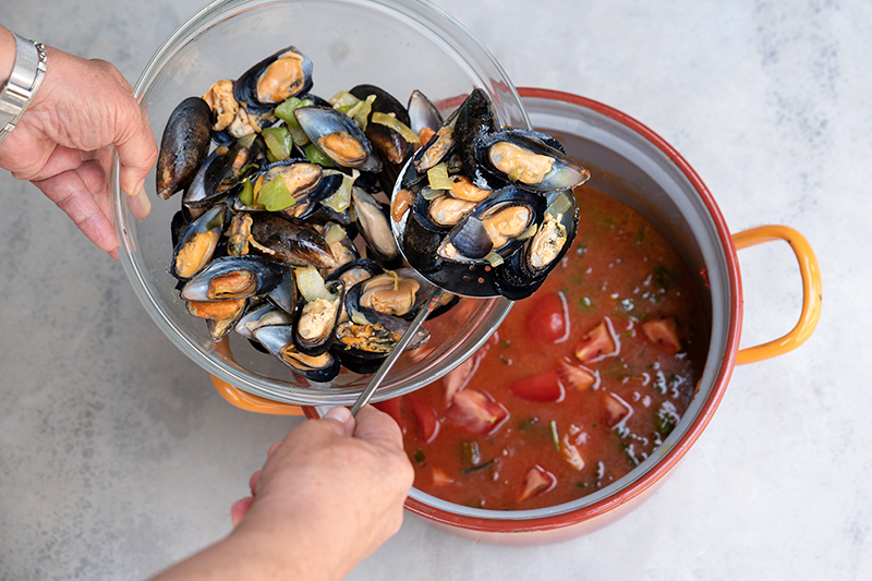 Making Mussels Saganaki Poros Greece