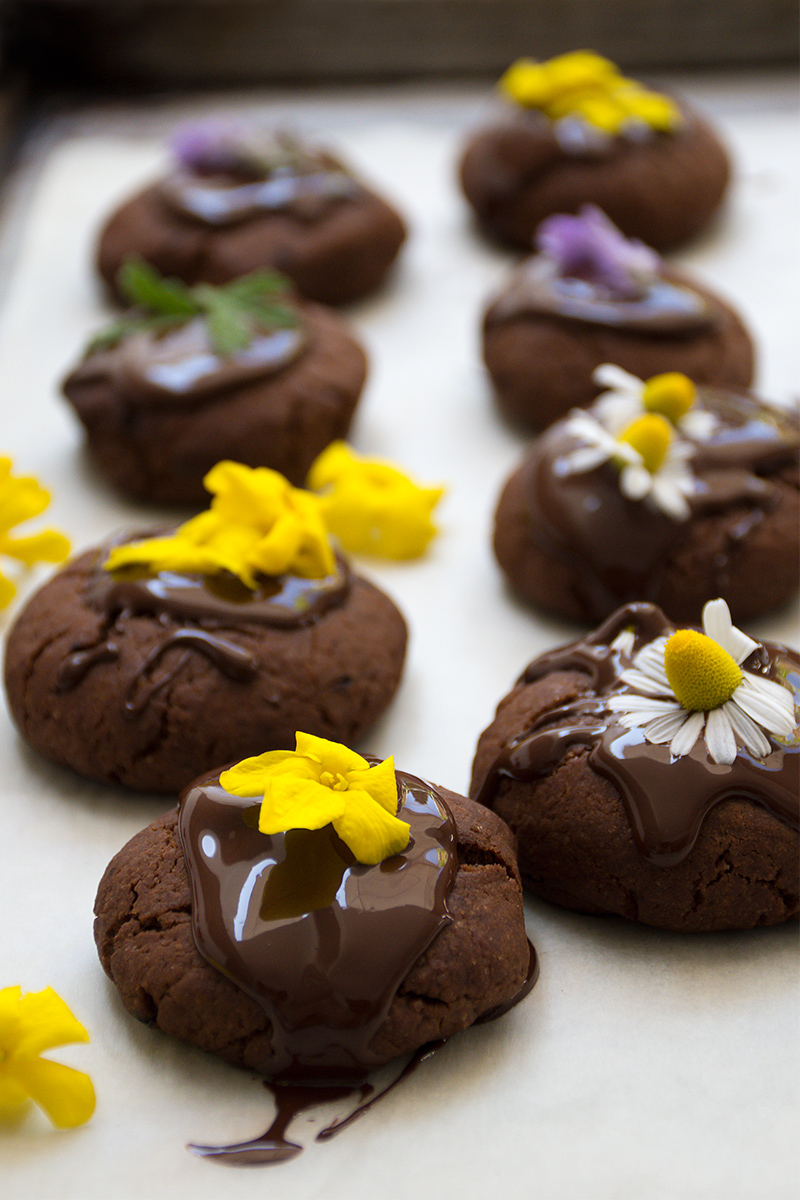 Freshly baked vegan chocolate cookies with edible flowers Odyssey Poros Greece food photography