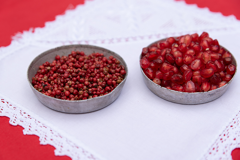Red peppercorns and pomegranate seeds Odyssey Poros Greece Christmas recipes