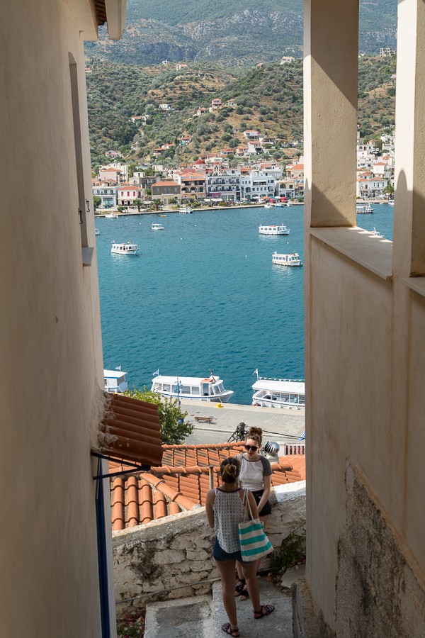 Views glimpsed between walls and narrow paths Poros-town Greece