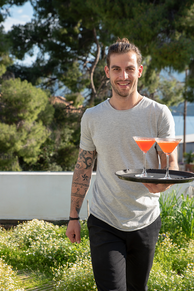 Vagellis serving Red Orange Blossom Cocktail